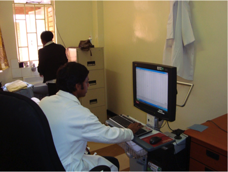 Dr. Siddiqi in neurophysiology laboratory