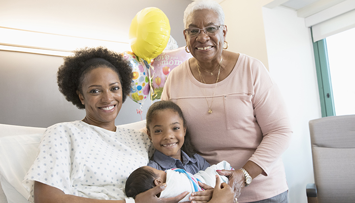 Black Parent, Grandparent, Child and Newborn