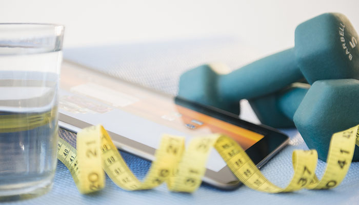 Dumbbells, Tape Measure and Water