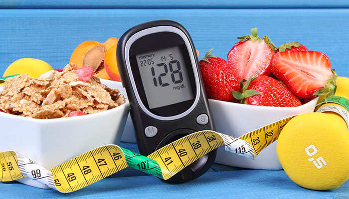 Glucose Meter, Healthy Foods and a Dumbell