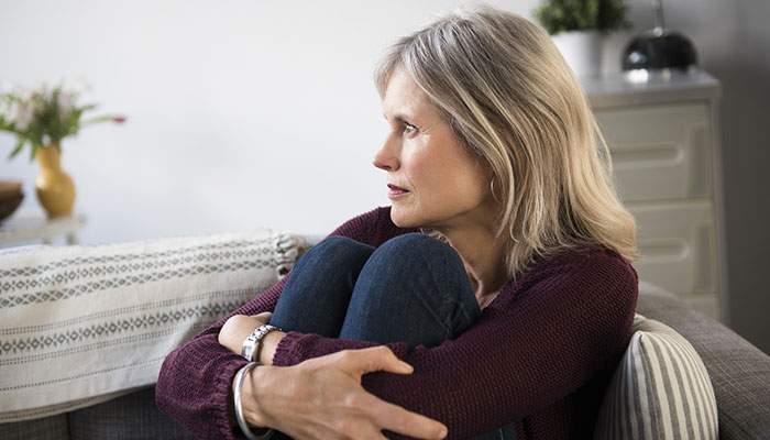Woman with feelings of cancer survivor guilt