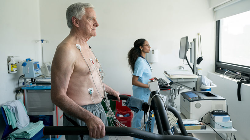 older man undergoing treadmill stress test