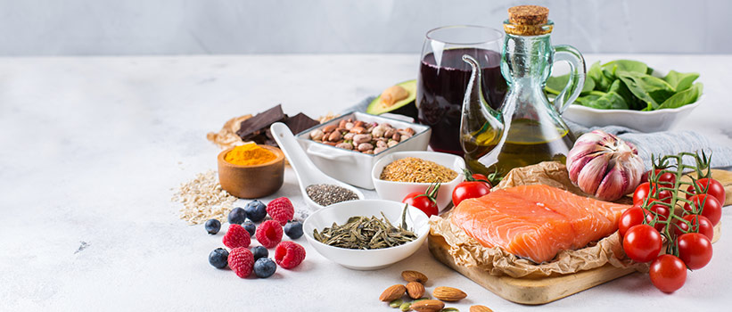 foods commonly eaten with the Mediterranean diet, including fish, olive oil, fruits, vegetables and grains