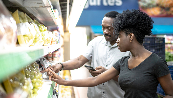 african american male and female shopping for healthy foods