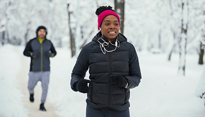 african american woman running outside in the winter