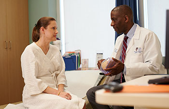 BIDMC's Dr. James speaks with a BreastCare Center patient