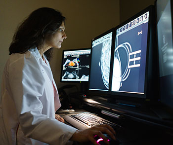 Dr. Mehta examines a patient's mammogram