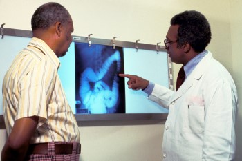 Physician going over gastrointestinal imaging with patient