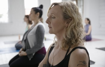 woman participating in BIDMC meditation class