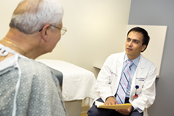 BIDMC's Pablo Quintero, MD with a patient