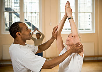 Parkinson's disease patient in tai chi class.