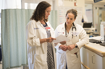 Jennifer Stevens and MD Morgan Soffler, MD of BIDMC review patient test results looking for sleep-related issues.