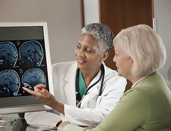 Brain Aneurysm Imaging - Doctor with Patient