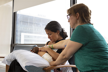 A mother and her newborn baby at BIDMC at a Breastfeeding Support Group