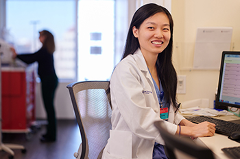 BIDMC OB/GYN resident Rui Wang, MD reviews a patient's information.