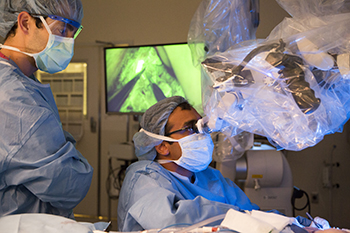 BIDMC's Dhruv Singhal, MD performs surgery on a patient with his colleague looking on.