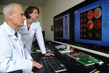Gerald Kolodny, MD of BIDMC reviews a patient heart scan with a colleague.