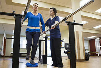 Patient undergoing physical therapy to improve balance
