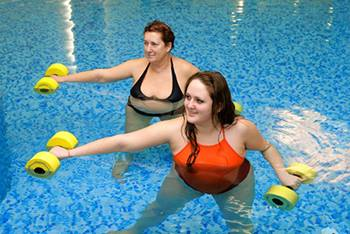 Two BIDMC patients doing physical therapy exercises in the rehab pool.
