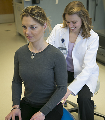 A physical therapy session between a BIDMC Physical Therapist and patient.