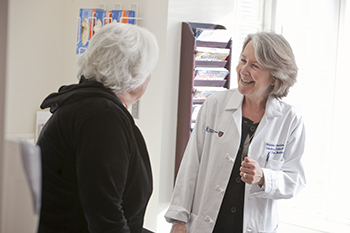 BIDMC Pain MD Christine Peeters Asodourian consults with a patient.