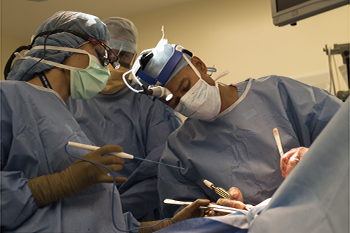 Sidhu Gangadharan, MD of BIDMC performs surgery on a patient.