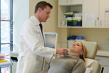 Ben James, MD, performs a pre-surgery ultrasound on a patient with hyperparathyroidism.