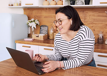 Woman watching Weight Loss Sugery Info Session online