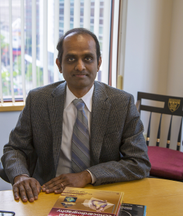 Dr. Subramaniam in his office