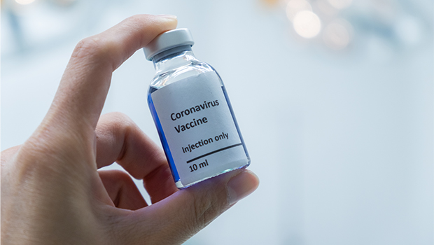Hand holding a vial of the coronavirus vaccine